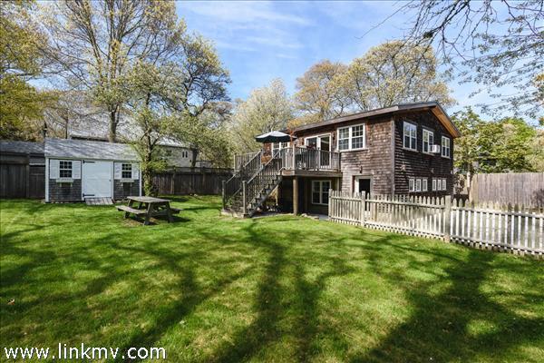 Home overlooks a beautiful green yard.