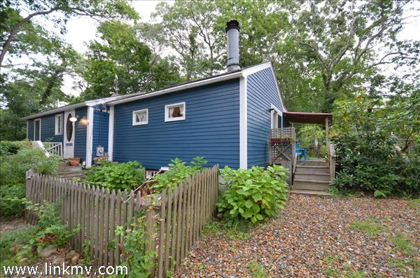Year Round home with 2 bedrooms and plenty of parking nestled in the East Chop Highland!