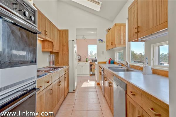 Kitchen opens to dining room and deck
