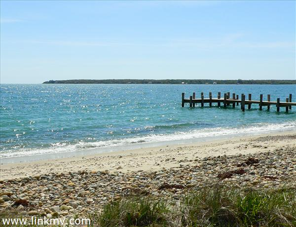 Looking east from beach path, East Chop and outer Vineyard Haven Harbor, neighboring dock.