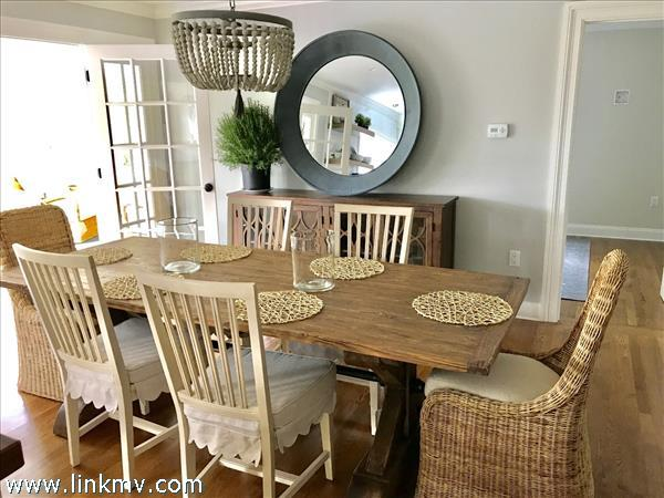 dining room with sun porch to left.