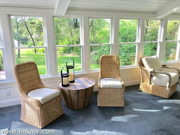 Enclosed Sun porch with views of rear yard and Koi pond.
