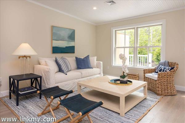 Living Area Features Vaulted Ceilings and Windows Overlooking the Deck and Gardens