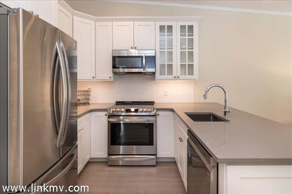 Galley Style Kitchen Features Stainless Steel Appliances
