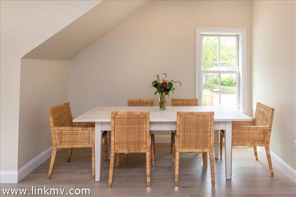 Dining Area Accommodates a Large Dining Table with Seating for Six
