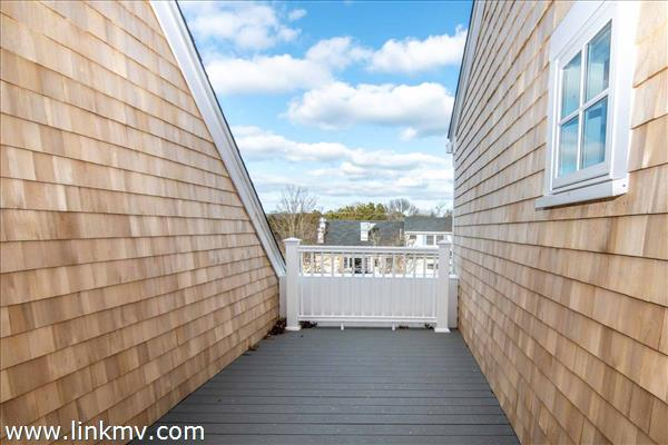 Small Deck Opens from Kitchen