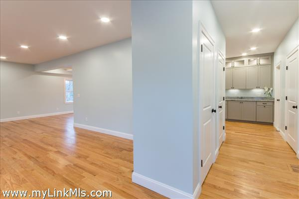Entry way opens to both kitchen and living room