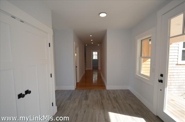 Entry hall/mudroom with double closets access to rear deck and finished 2 car garage with large unfinished flex space above