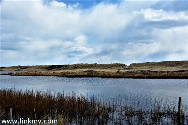 short paddle or wade across close-by Chilmark Pond to deeded beach