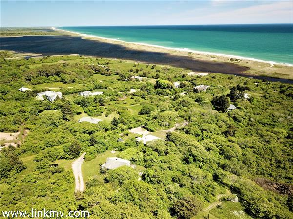 cottage in foreground and Chilmark Pond below