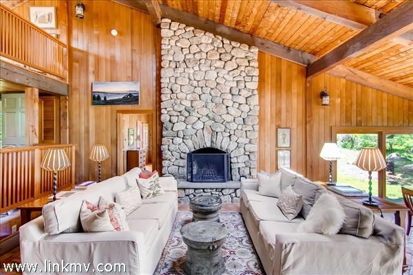 The stone fireplace with cathedral ceiling