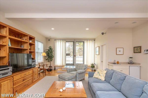 Spacious Living Room Has Wet Bar with Refrigerator