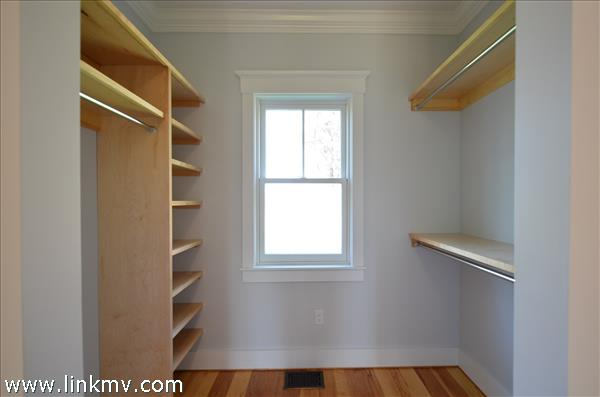 Built-in wood shelving in closets