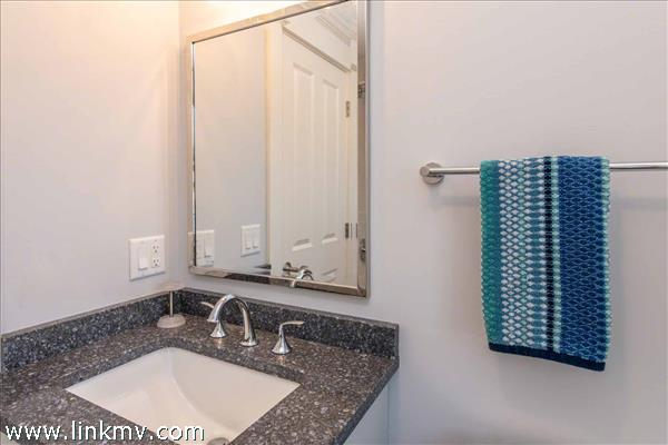 Shared Second Floor Bathroom Has A Tub and Shower Combination