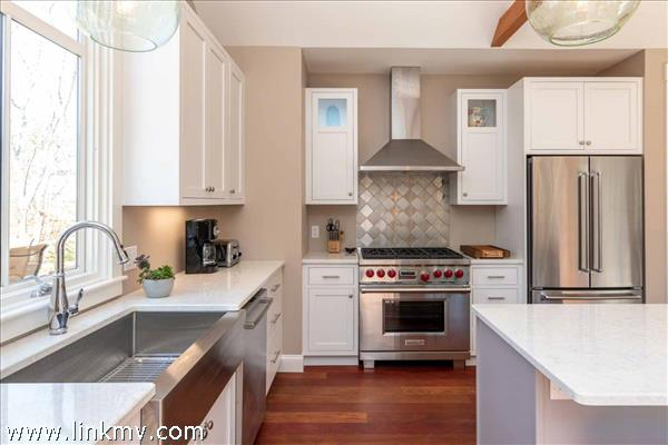 Kitchen Has Stainless Steel Appliances Including a Gas Wolf Stove and Farmers Sink