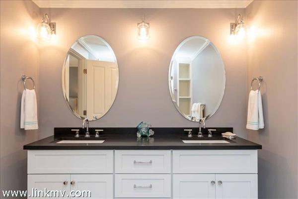 Master Bathroom Has Vanity with Granite Counter Top and Two Sinks