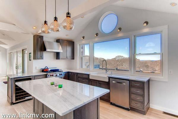 with high end appliances including  Wolf gas range, Bosch Dishwasher, GE Monogram refrigerator,