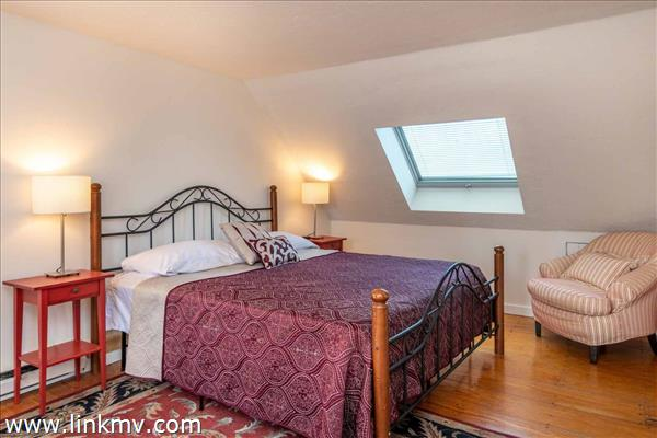 Master Bedroom Has Slanted Ceilings and Skylight - Second Floor