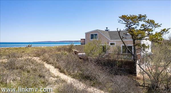 The house is perched on a bluff overlooking the beach off of Oxcart Road.