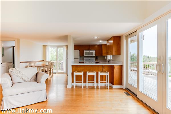 The open concept living space is open and filled with light.
