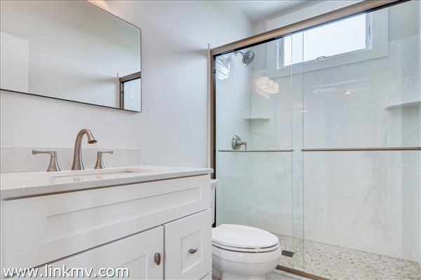 Shared guest bathroom was recently freshly updated.