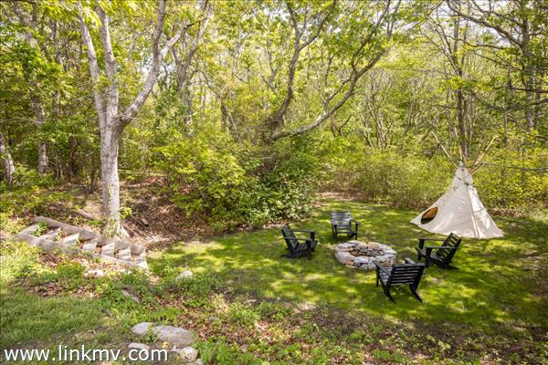 Secluded firepit with teepee