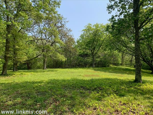 The lot abuts 185 acres of conservation land.