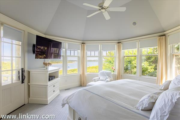 The master bedroom is secluded and offers sweeping water views