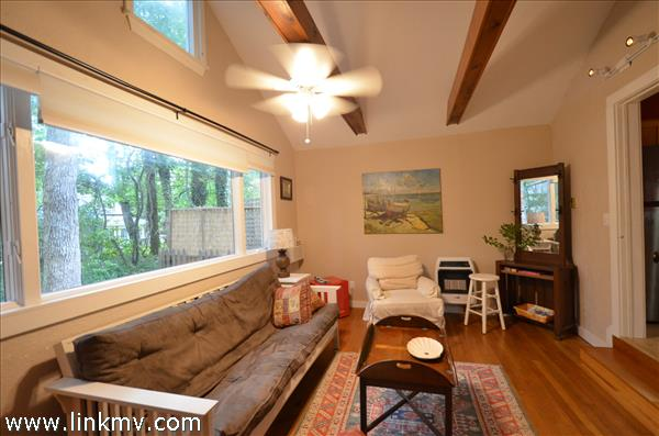 Open Bright living area with sturdy wood beam!