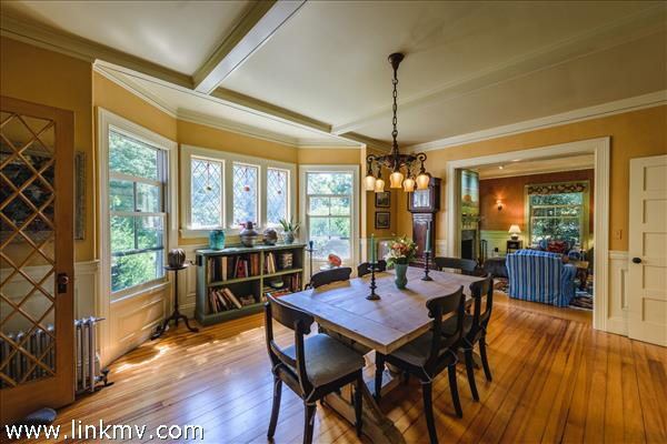 Dining room features a south facing bay window with diamond pane leaded glass