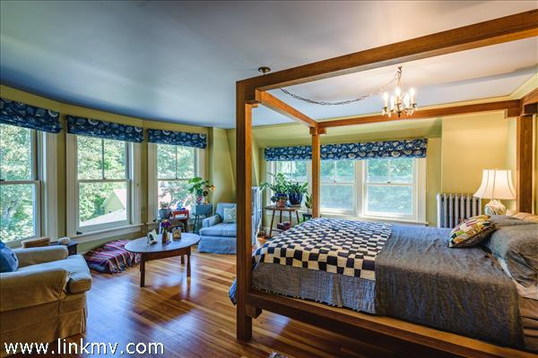 Master Bedroom features an array of east facing windows.