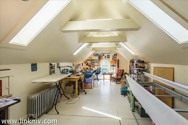 Finished attic features a large studio with heat , an AC split and skylights providing lots of natural light.