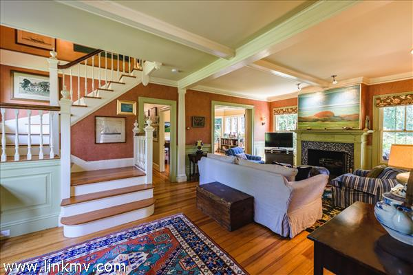 Lovely foyer with view to the living room and dining room beyond.