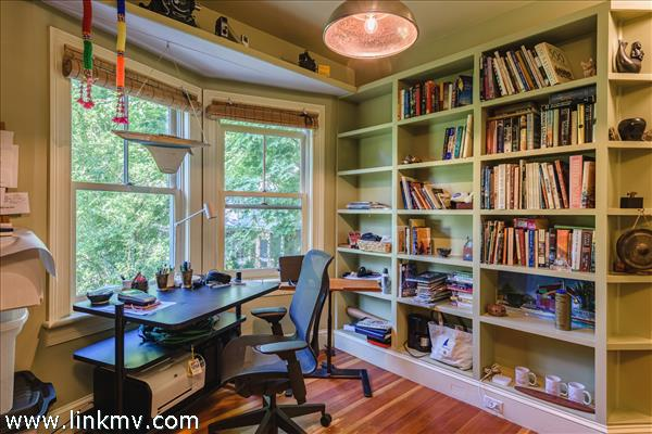 First floor study with built in book shelves and angled window provides lots of natural light.