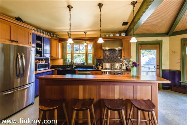 Breakfast bar with custom top provides extra seating.