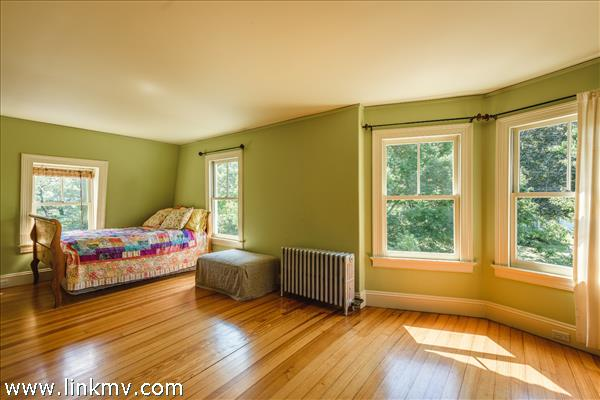 Second floor front bedroom with south and west facing windows