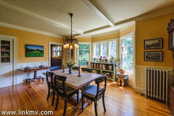 A built in corner china cabinet, beamed ceilings, wainscoting, beautiful Carolina pine floors