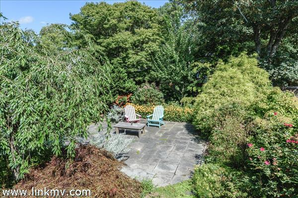 Bluestone patio surrounded by roses, Japanese Maple, Weeping Cherry and Rose of Sharon.
