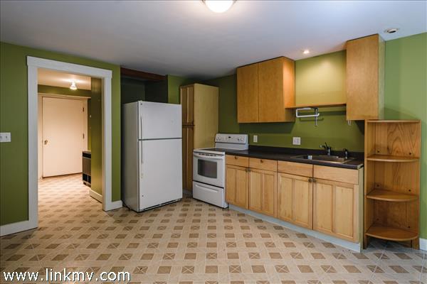 Kitchen area of studio apartment.