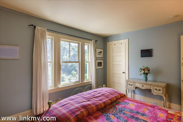 Second guest room with south facing window overlooking side grounds.