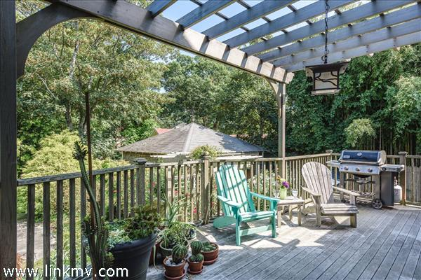 Pergola covered rear deck for dining and relaxing