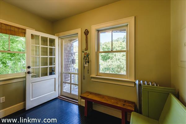Convenient mud room entry to the rear of the house.