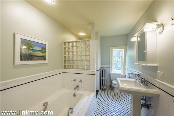 Second floor family bath withseparate  tub and shower.