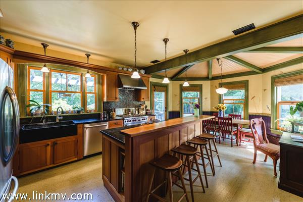 Spectacular gourmet kitchen with top of the line appliances, breakfast dining area and access to the rear deck with pergola.