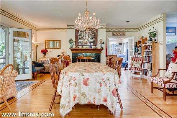 Formal dining room with inlaid wood flooring