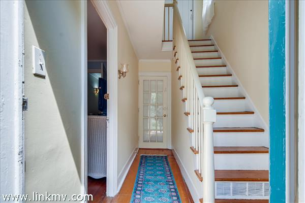 The original 1784 staircase leads to bedroom #3 downstairs #4 upstairs