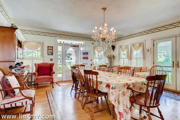 Formal dining room that opens to the porch