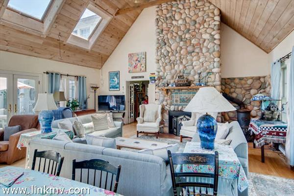 The living room with stone fireplace