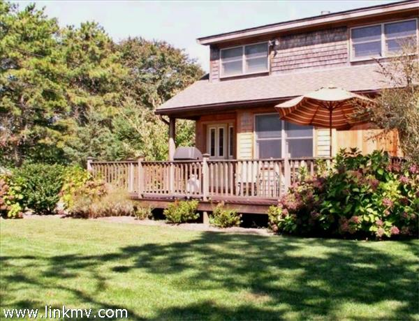 Expansive Back Deck with outdoor shower overlooking nicely Landscaped Yard