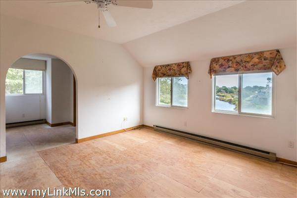 Master suite enjoys privacy and overlooks the Pond.
